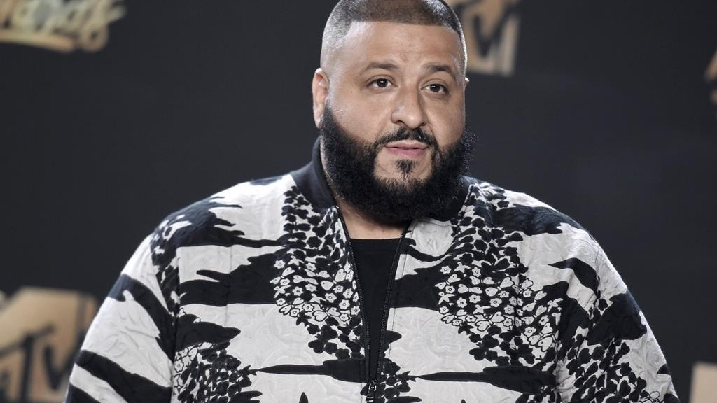FILE - In this Sunday, May 7, 2017 file photo, DJ Khaled arrives at the MTV Movie and TV Awards at the Shrine Auditorium in Los Angeles. A group of future number-crunchers had their commencement crashed by DJ Khaled. The hip-hop star and social media celebrity gave a surprise performance at the ceremony Wednesday, May 17, 2017, for statistics graduates at the University of California, Berkeley. (Photo by Richard Shotwell/Invision/AP, File)